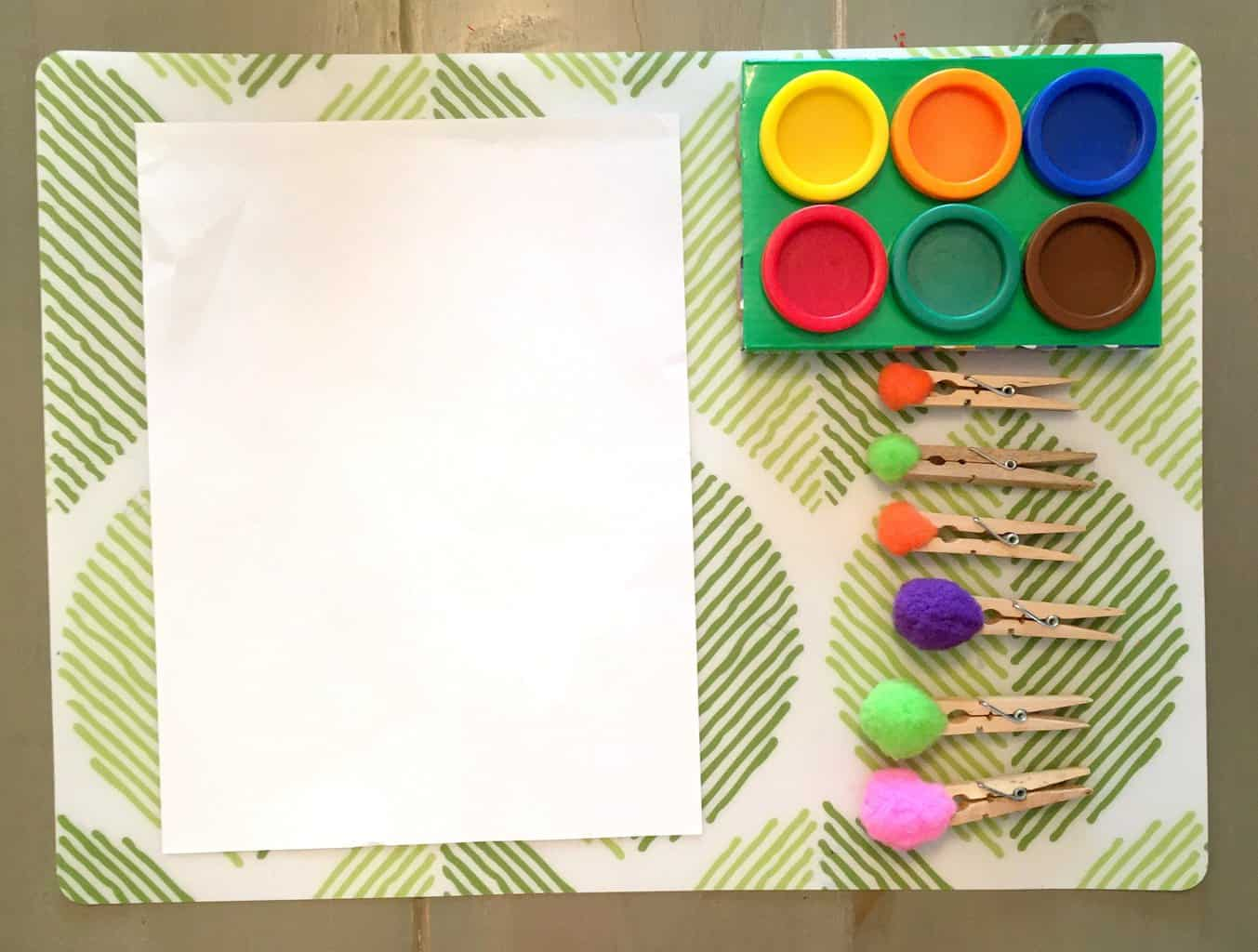 Materials: Pom poms, clothespins, paint, and construction paper