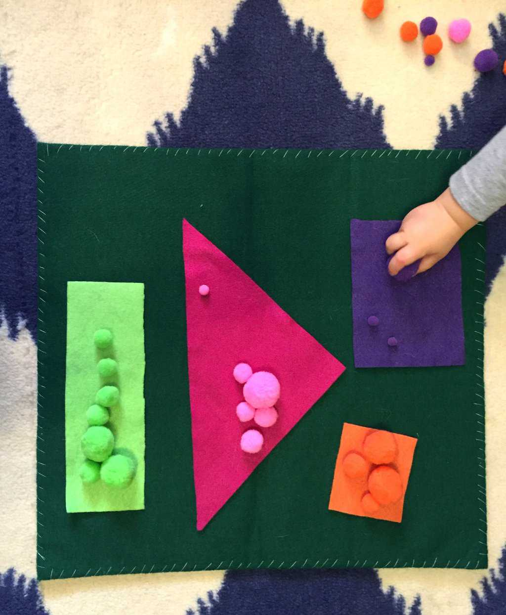 Looking for a fun toddler activity to teach colors? Try this pom poms color sorting game! Simple, easy prep, and tons of fun! It's perfect to teach early learning colors and develop fine motor skills. Read on for tips and tricks to engage your child.
