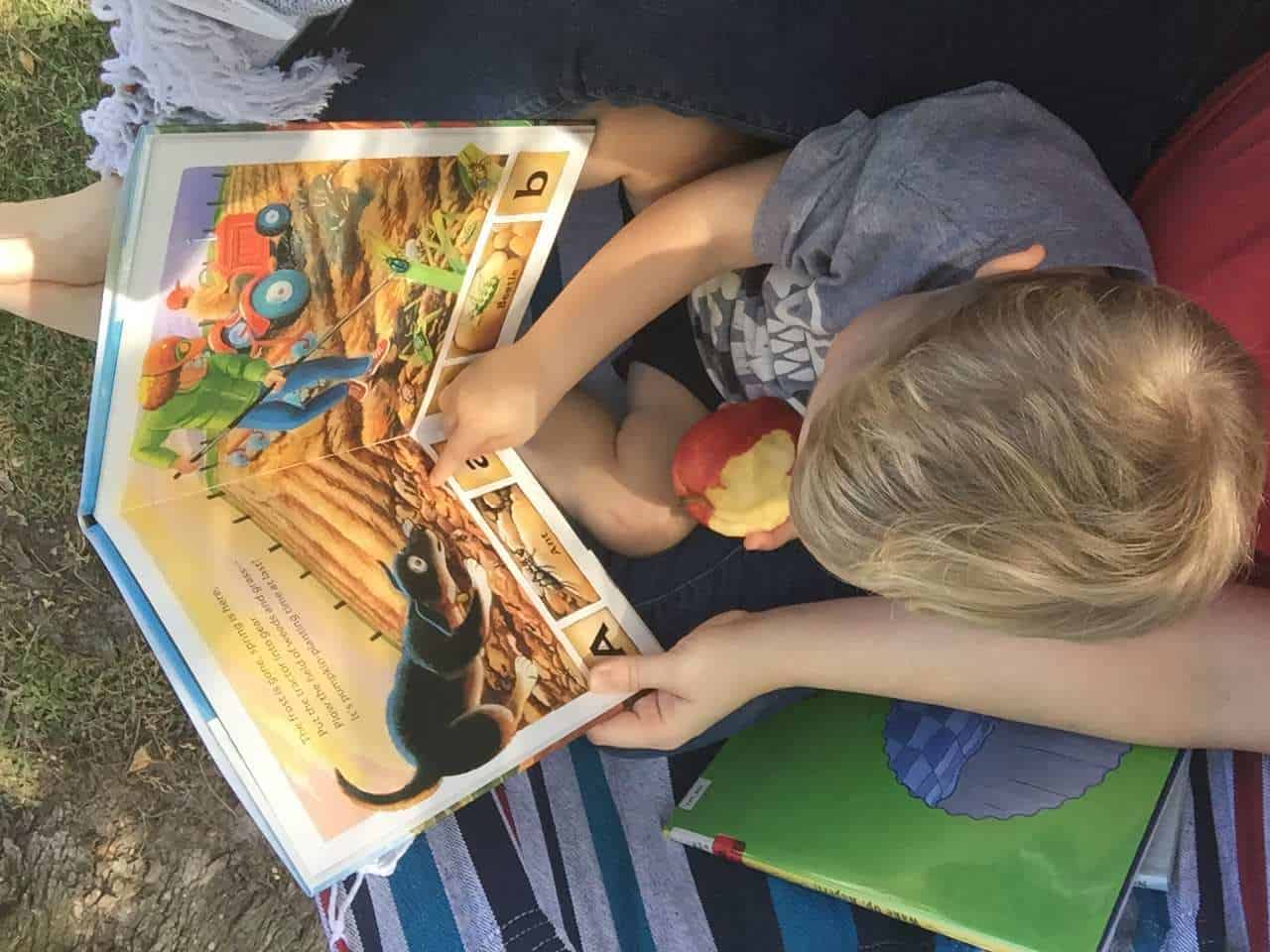 """Overwhelmed with homeschool preschool? Learn how we do homeschool preschool the relaxed way and still get real learning done! I'll give you a hint: it doesn't look much like """"school."""" It looks like life! Click through to steal our top tips and tools for homeschool preschool!"""