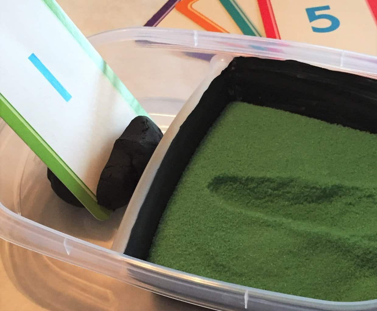 Make your own DIY salt or sand tray for a preschool and toddler writing activity! You can make custom colored salt and create an easy, portable salt tray to help with fine motor, sensory, and pre-writing activities for your little one. Click through for the quick and easy tutorial that will save you big money on preschool supplies too!